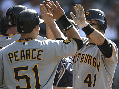 Ryan Doumit hits a grand slam for the Pirates, who have already won five road series, one more than all of last year. (AP)