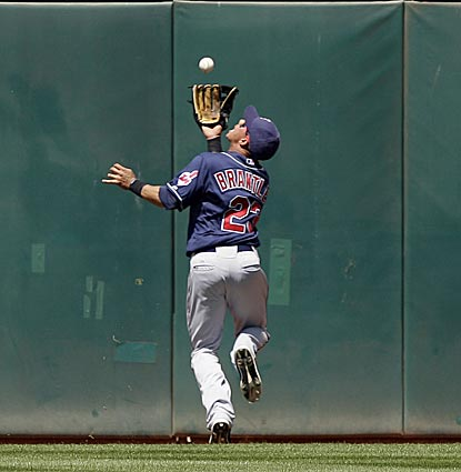 Cleveland center fielder Michael Brantley makes an over-the-back catch on Daric Barton's fly ball in the eighth inning.  (AP)