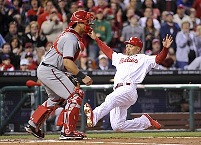 Moments after hitting a two-run double, Raul Ibanez scores on Wilson Valdez's single during Philly's six-run third inning.  (US Presswire)