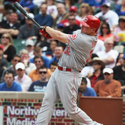 Jay Bruce powers through a three-run shot off the Cubs' Matt Garza in the fourth.  (Getty Images)