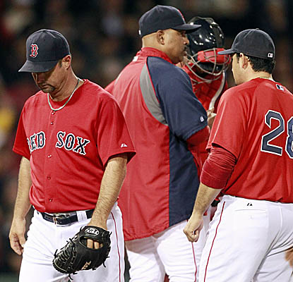 Red Sox starter Tim Wakefield walks off the mound after getting pummeled by the Twins on Friday. (AP)