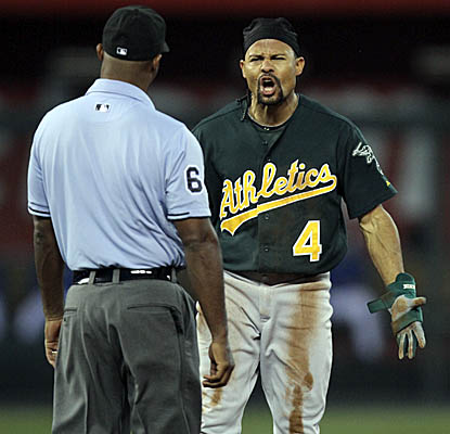 Coco Crisp has some words with second base umpire Alan Porter after being called out on a steal. (AP)