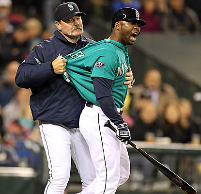 Milton Bradley is restrained by Mariners manager Eric Wedge after getting tossed vs. the White Sox. (Getty Images)