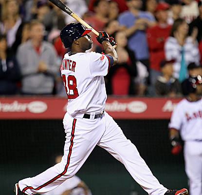 Torii Hunter connects for the game-winning RBI single in the 11th inning to put away the Indians. (AP)