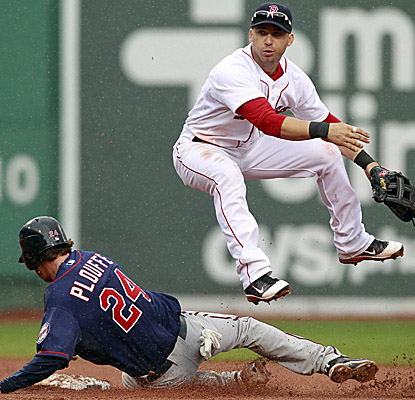 Trevor Plouffe is forced out at second as Boston's Marco Scutaro turns the double play in the sixth inning. (AP)