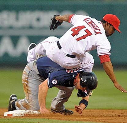Angels second baseman Howie Kendrick forces out Indians third baseman Jack Hannahan in the third inning. (US Presswire)