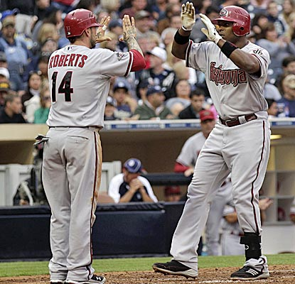 The Diamondbacks' Justin Upton, right, is greeted by Ryan Roberts after scoring on Upton's two-run homer.  (AP)