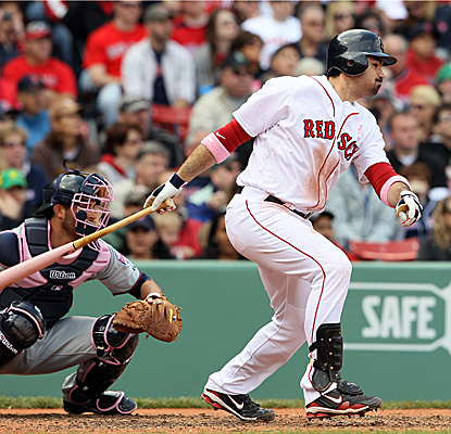 Adrian Gonzalez connects for a single vs. the Twins in Boston on Sunday. (Getty Images)
