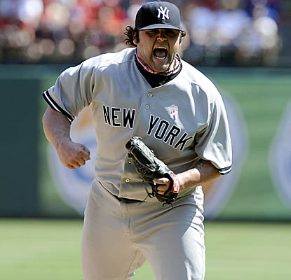 Reliever Joba Chamberlain celebrates after getting the final out of the seventh vs. the Rangers. (AP)