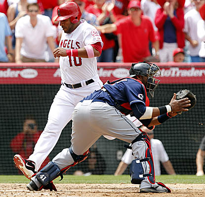 Vernon Wells crosses the plate on a double by Alberto Callaspo as the Angels edge the Indians. (AP)