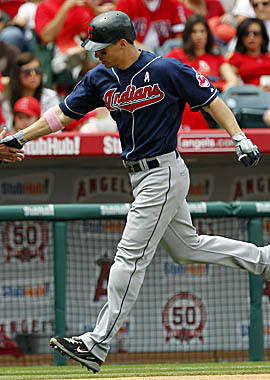 Grady Sizemore rounds third after hitting a solo home run in Cleveland's loss Sunday. (AP)