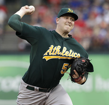 Trevor Cahill tames the potent Rangers' offense through seven strong innings and drops his ERA down to a scorching 1.72.  (AP)