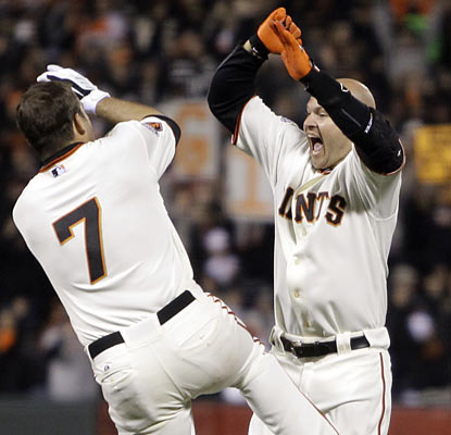 Cody Ross (right) celebrates after hitting a game-ending RBI single in the ninth to give the Giants their fourth straight win. (AP)