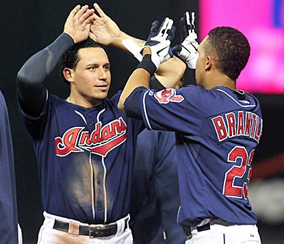 Asdrubal Cabrera (left) celebrates with Michael Brantley, whose walk-off walk lengthens Cleveland's home streak.  (US Presswire)