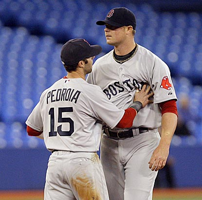 Dustin Pedroia tries to calm Jon Lester, who gets upset after some close calls go against him in the first inning.  (Getty Images)