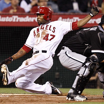 Howard Kendrick scores on a hit by Albert Callaspo to help the Angels finish off the White Sox.  (AP)
