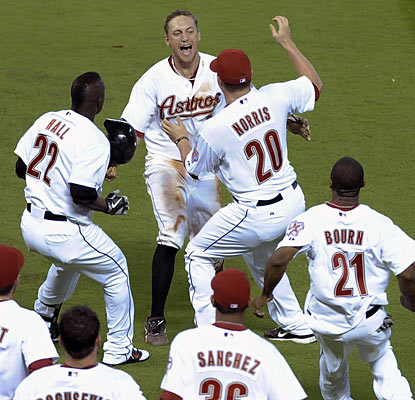 Hunter Pence receives a grand welcome party after he drives in the winning run in the ninth inning. (AP)