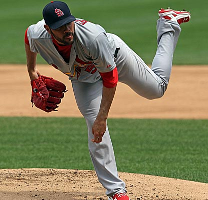 Jaime Garcia keeps the Cubs hitless until the sixth inning, when he gives up three straight singles. (Getty Images)