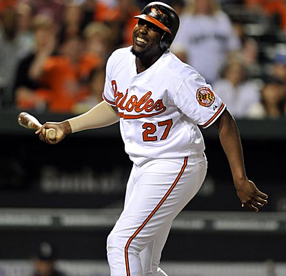 O's DH Vladimir Guerrero reacts to getting beaned by closer Brandon League in the 12th inning. (AP)