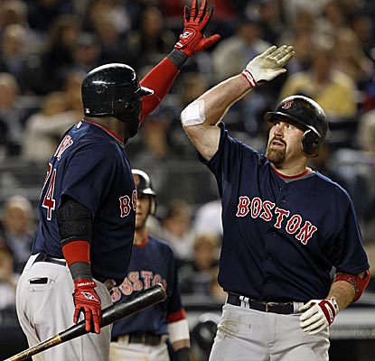 David Ortiz congratulates Red Sox teammate Kevin Youkilis for his two-run home run in the seventh. (AP)