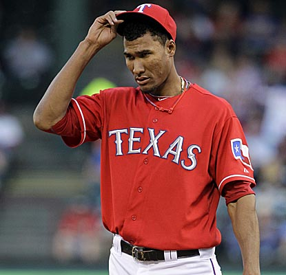 Rangers starter Alexi Ogando allows one run and five hits in just over six innings vs. the Angels. (AP)