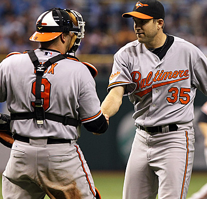 Orioles catcher Jake Fox congratulates Brad Bergesen on his first big-league shutout. (US Presswire)