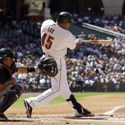 Carlos Lee swings through his 2,000th career hit; becoming the 17th active player to reach that milestone.  (Getty Images)
