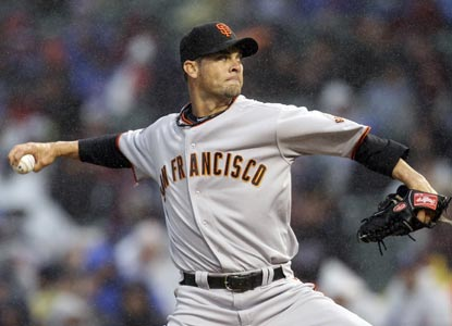 Ryan Vogelsong pitches six scoreless innings and grabs his first career shutout in a rain-shortened game against the Cubs. (Getty Images)