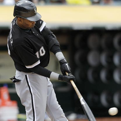 A few good swings by Alexei Ramirez help the ChiSox hand Oakland's Trevor Cahill his first loss of the season. (AP)