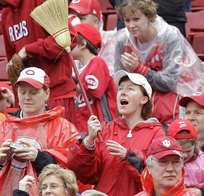 Cincinnati fans bust out the brooms as the Reds sweep St. Louis at home for the first time since 2007.  (AP)