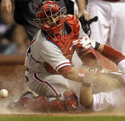 Nick Punto is safe at home as Phillies catcher Carlos Ruiz is unable to control the ball.  (AP)