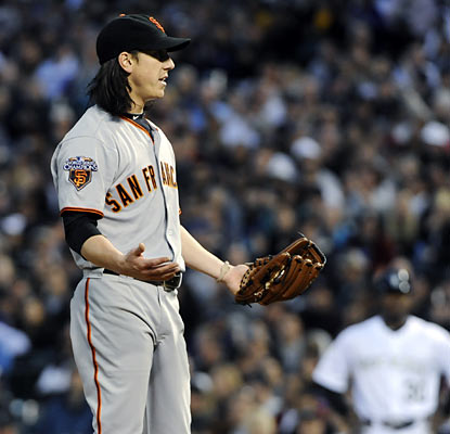 Tim Lincecum doesn't know what to make of his rough start in Denver, giving up seven runs (three earned) in 5 2/3 innings.   (AP)
