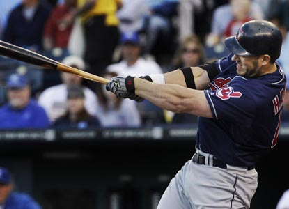 Travis Hafner swings through a three-run double in the first inning to help the Indians romp the Royals. (AP)