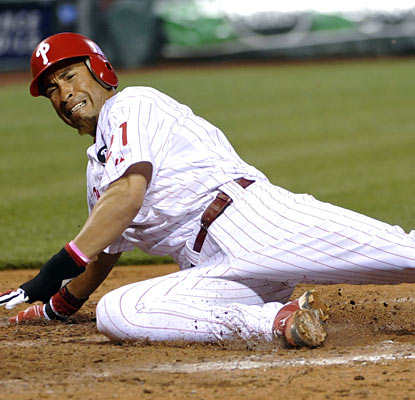 Wilson Valdez slides in for the winning run on a sacrifice fly from Jimmy Rollins in the eighth inning.  (US Presswire)