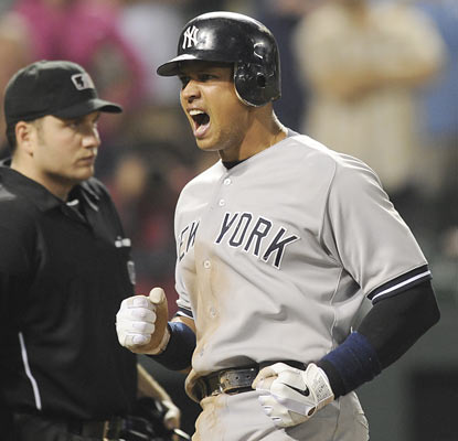 Alex Rodriguez, who ties a season-high with four hits, scores twice, including an insurance run in the 15th.  (AP)