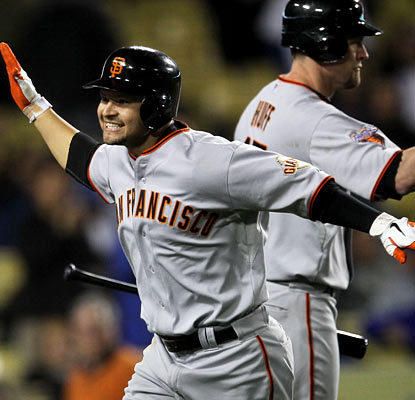 Cody Ross comes through for the Giants once again, knocking the tie-breaking, three-run shot in the ninth inning.  (AP)