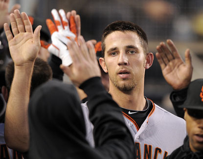 San Francisco's Madison Bumgarner is congratulated by teammates after scoring on a sacrifice fly. (AP)