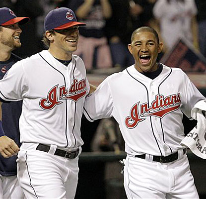 Rookie Ezequiel Carrera celebrates with his Indians teammates after his pinch-bunt scored the winning run. (AP)