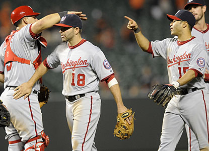 Danny Espinosa (18) is responsible for five of Washington's record-setting 17-run production. (AP)