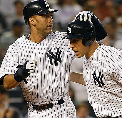 Derek Jeter likes how Mark Teixeira is playing these days. The Yankees first baseman homers in his third straight game.  (Getty Images)