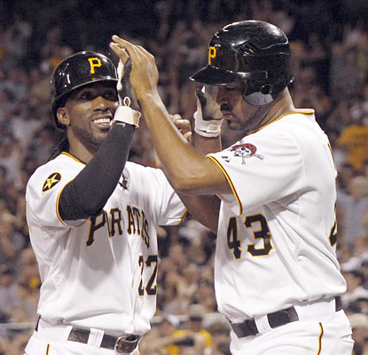 The Pirates' Andrew McCutchen (left) helps put a hurting on the Tigers as he finishes the game with three hits and two runs.  (AP)