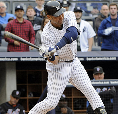 Derek Jeter bangs a two-run single in the seventh as the Yankees rally past the Mets. (AP)