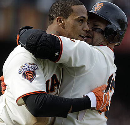 Speedy Darren Ford (left) scores the winning run in the bottom of the 11th for the red-hot Giants.  (AP)