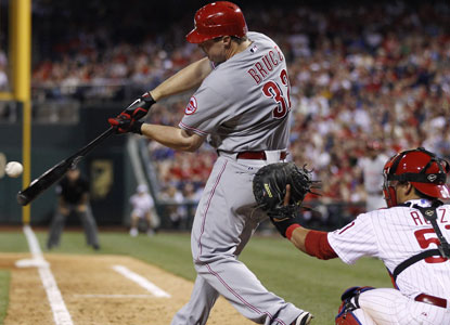 Jay Bruce comes through in the ninth for the Reds, who had lost eight straight to the Phillies.  (AP)