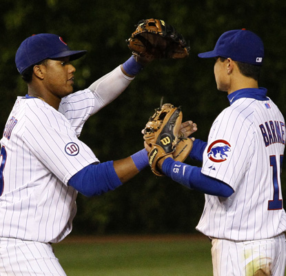 Cubs' shortstop Starlin Castro, left, and second baseman Darwin Barney celebrate their 11-1 win over the New York Mets (AP)