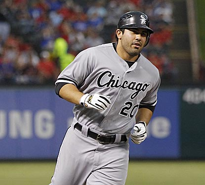 Carlos Quentin heads for the plate after his second home run -- a three-run shot that gives Chicago a 4-1 lead.  (US Presswire)