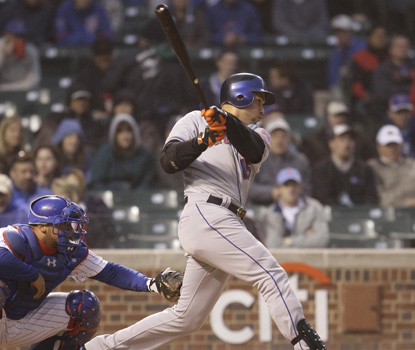 The Mets' Carlos Beltran connects for a two-run double in New York's five-run second inning. (AP)
