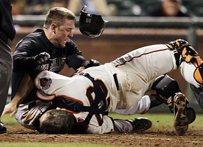 Scott Cousins scores the winning run and also collides with Buster Posey, who leaves injured. (AP)