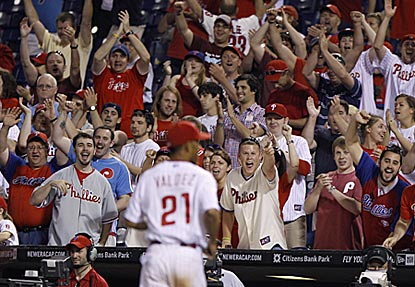 Phillies fans salute Wilson Valdez after his scoreless 19th, then explode minutes later when he becomes the winning pitcher.  (AP)