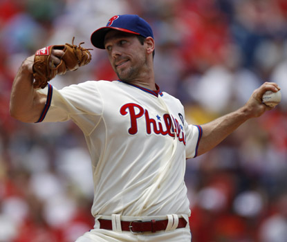 Cliff Lee pitches eight innings, and drives in three runs with a double and a single in the Phillies' win over Cincinnati. (AP)